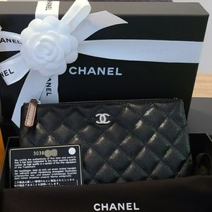 Brand new Chanel Small O Pouch with SHW